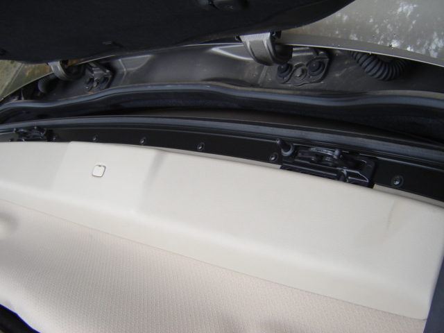 Remove The Plastic Molding Under Lead Edge Of Convertible Top Move To Down Position Just Before Trunk Lid Not Really